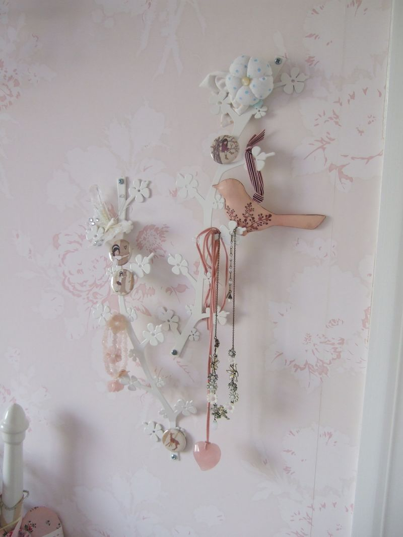 (my wallpaper is from Laura ashley here in the Uk) The fabric flower at the