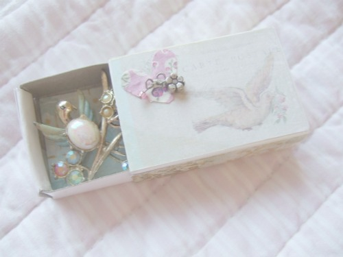 Bird matchbox with vinatge brooch